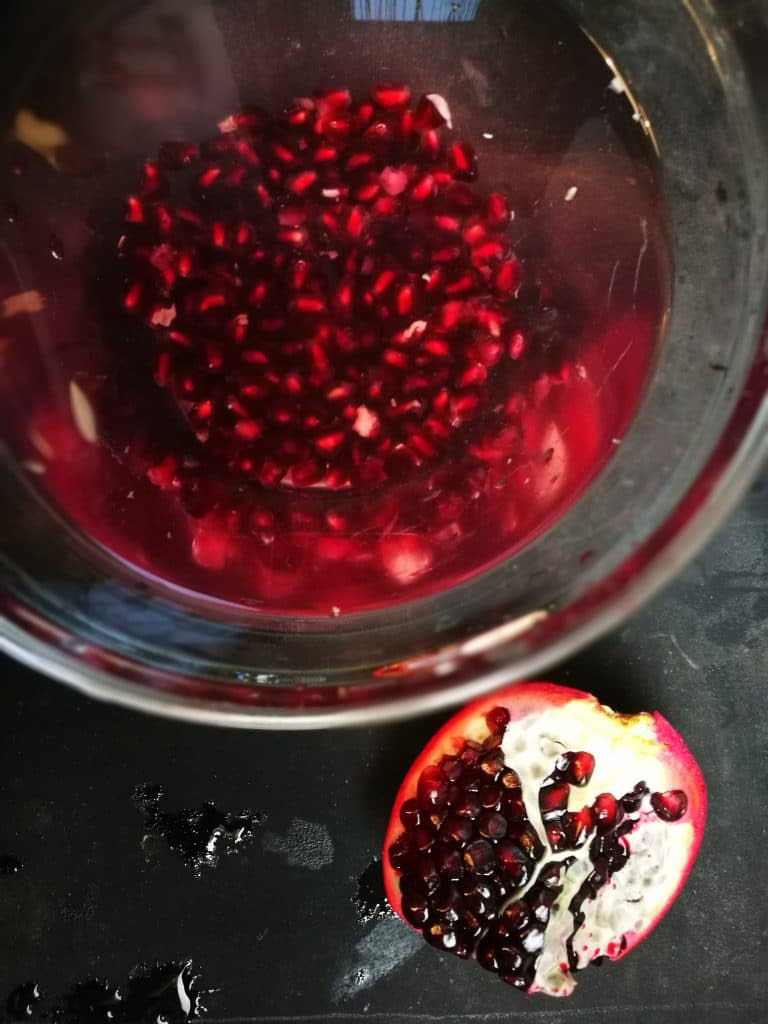 I now have been removing the seeds in a bowl of water and this technique works great. There are two kinds of pomegranates, the ones with pink arils/seeds are sweeter and the dark red ones which I prefer for their amazing power. Just a few benefits of pomegranates, I need to include these here, They contain three times as many antioxidants then green tea They also have anti-viral and anti-tumor properties Rich in vitamins, especially A, C and E as well as folic acid Useful to maintain and restore a healthy blood circulation Great for treating skin issues and sore throats Pomegranates are a great support in heart related problems, diabetes, cancer, stomach disorders, anemia and arthritis
